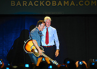 LAURA FONG | Bruce Springsteen rocked and former U.S. President Bill Clinton talked.  Both touted Barack Obama's compassion for the middle class calling out the Romney campaign for being out of touch with the average American.