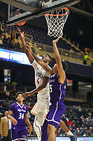 Washington, DC - December 22, 2018: Richmond Spiders forward Nathan Cayo (4) is fouled by High Point Panthers forward Ricky Madison (25) during the DC Hoops Fest between Hampton and Howard at  Entertainment and Sports Arena in Washington, DC.   (Photo by Elliott Brown/Media Images International)