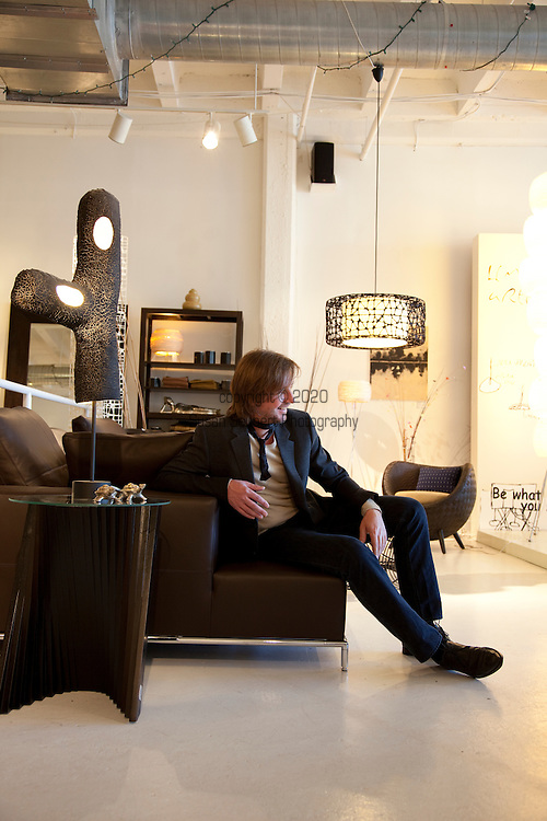 Muléh, a modern furniture and clothing store in the U Street district of Washington D.C. Pictured here is store owner Christopher Reiter, testing out one of the many couches in the store.