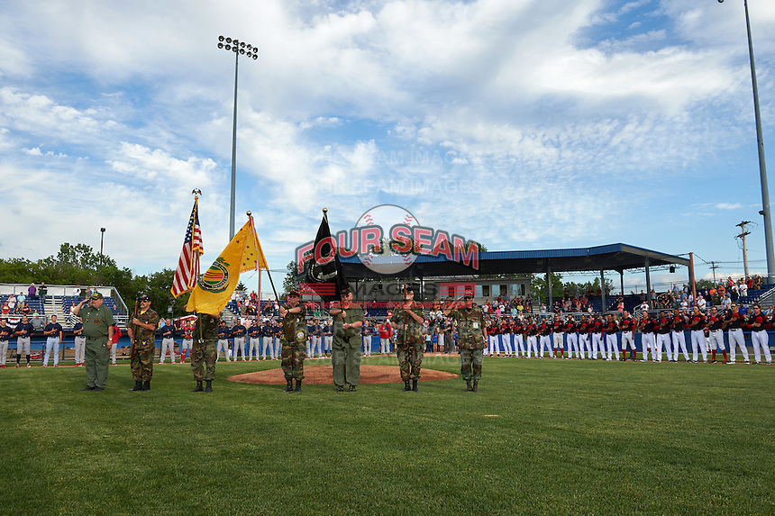 Batavia Muckdogs flag presentation during the national anthem before a game against the State College Spikes on June 22, 2016 at Dwyer Stadium in Batavia, New York.  State College defeated Batavia 11-1.  (Mike Janes/Four Seam Images)