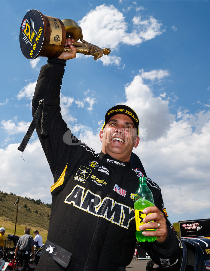 Jul 24, 2016; Morrison, CO, USA; NHRA top fuel driver Tony Schumacher celebrates after winning the Mile High Nationals at Bandimere Speedway. Mandatory Credit: Mark J. Rebilas-USA TODAY Sports