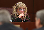 Nevada Assemblywoman Jill DIckman, R-Sparks, works in committee at the Legislative Building in Carson City, Nev., on Tuesday, March 3, 2015. <br /> Photo by Cathleen Allison