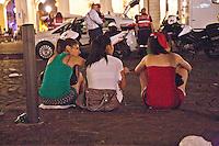 01/07/2012 Finale dei campionati europei di calcio 2012  Italia - Spagna: delusione dei tifosi in piazza a Torino. Tre ragazze sedute su un marciapiede dopo la partita.