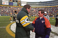 Green Bay Packers Coach Mike Holmgren and Denver Broncos Coach Mike Shanahan say hello prior to the December 8, 1996 game at Lambeau Field. The Pack won the contest 41-6.