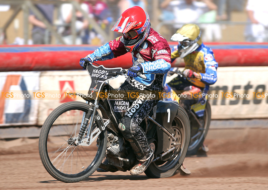 Heat 15: Lee Richardson (red) is chased by Joonas Kylmakorpi (yellow) - Lakeside Hammers vs Eastbourne Eagles, Elite League Speedway at the Arena Essex Raceway, Purfleet - 22/04/11 - MANDATORY CREDIT: Rob Newell/TGSPHOTO - Self billing applies where appropriate - 0845 094 6026 - contact@tgsphoto.co.uk - NO UNPAID USE.