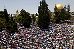 Palestinians gather to perform the last Friday prayers of the Muslim holy month of Ramadan at the Aqsa mosque compound in the old city of Jerusalem on June 8, 2018. Photo by Muammar Awad
