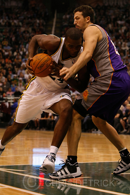 Chris Detrick  |  The Salt Lake Tribune .Utah Jazz power forward Paul Millsap #24 is guarded by Phoenix Suns center Robin Lopez #15 during the first half of the game Thursday October 28, 2010.  Phoenix is winning the game 58-42.