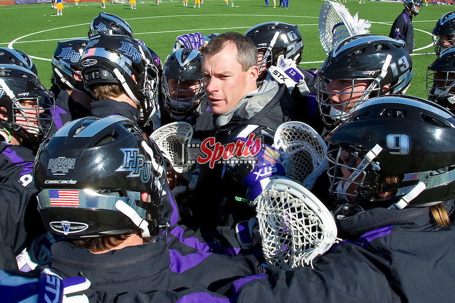 High Point Panthers head coach Jon Torpey speaks with his team prior to the game against the Delaware Blue Hens at Vert Track, Soccer & Lacrosse Stadium on February 2, 2013 in High Point, North Carolina.  The Blue Hens defeated the Panthers 12-10.   (Brian Westerholt/Sports On Film)