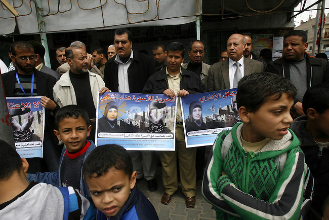 Palestinians hold portraits of jailed compatriot Hana Shalabi, in Rafah on the southern Gaza Strip on, 25 March 2012. Reports state that Hana Shalaby a Palestinian prisoner in an Israel prison has been on a hunger strike since her latest arrest on 16 February 2012. She is one of five Palestinians to have been rearrested after being released in the Hamas-Israel prisoner swap in Ocotber 2011. An Israeli Army spokesman has stated that Shalabi was 'a global jihad-affiliated operative.  Photo by  Eyad Albaba