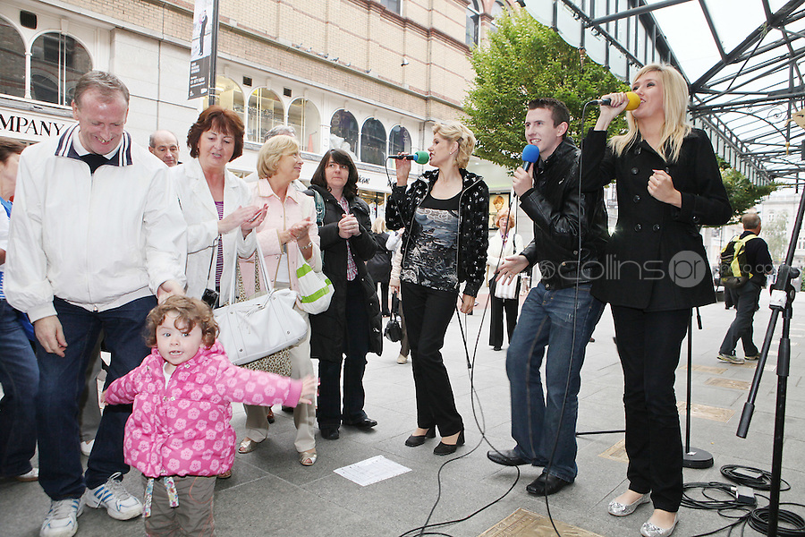 13/10/2010. Crystal Swing Busking. 2 year old fan Ciara Reed dances with Mary, Derek and Dervla Burke from Cork band Crystal Swing as they launch the busking contest outside the Gaiety Theatre, Dublin for the Mooney radio show on RTE. Picture James Horan/Collins Photos