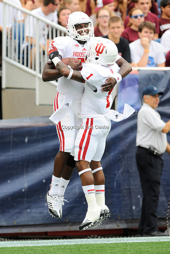 September 8, 2012 Indiana Hoosiers quarterback Tre Roberson #5 and wide receiver Shane Wynn #1 celebrate Roberson's touchdown during the Indiana Hoosiers  vs University of Massachusetts Minutemen game held at Gillette Stadium in Foxborough, Massachusetts.  Eric Canha/CSM