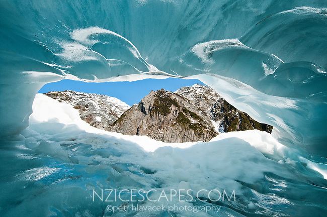 Beautiful texture and shapes of an ice cave in middle parts of Franz Josef Glacier - Westland National Park, West Coast, New Zealand