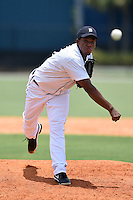 GCL Tigers pitcher Gerson Moreno (12) delivers a pitch during a game against the GCL Blue Jays on June 30, 2014 at Tigertown in Lakeland, Florida.  GCL Blue Jays defeated the GCL Tigers 3-1.  (Mike Janes/Four Seam Images)