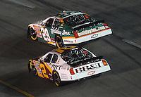 May 4, 2007; Richmond, VA, USA; Nascar Busch Series drivers Jeff Burton (29) and Clint Bowyer (2) battle for the lead during the Circuit City 250 at Richmond International Raceway. Mandatory Credit: Mark J. Rebilas