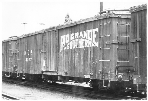 3/4 view of RGS box car 3257 at Durango.  The Sunrise logo is most likely a hoax, according to Dorman.<br /> RGS  Durango, CO  Taken by Pollack, Tom - ca. 1948<br /> In book &quot;Durango: Always a Railroad Town (1st ed.)&quot; page 172<br /> See RD054-028 for a companion picture.