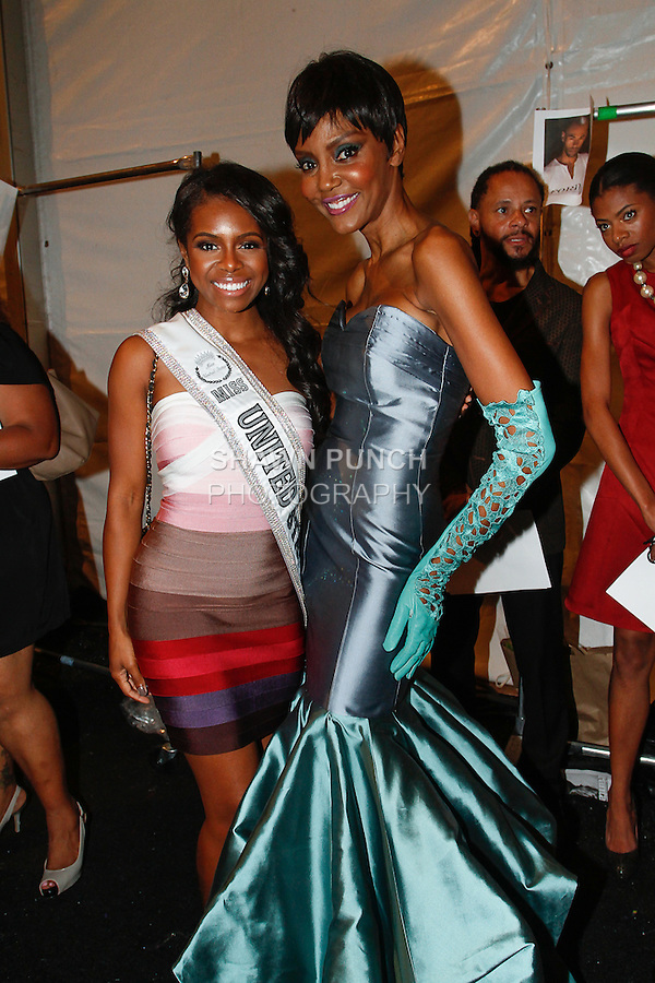 Candiace Dillard, 2013 Miss United States, District of Columbia, posing with Lu Sierra backstage after the b michael AMERICA Couture Spring 2014 fashion show, during Mercedes-Benz Fashion Week Spring 2014 in New York, on September 11, 2013.
