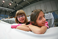 Young fans from Portugal have happy moment at 2007 Portimao World Cup of Rhythmic Gymnastics on April 28, 2007 at Portimao, Portugal.  (Photo by Tom Theobald)..