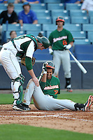 "Miami Hurricanes Harold Martinez #9 is checked on by catcher Daniel Rockhold  #18 after getting hit in the head by a pitch during a game vs. the University of South Florida Bulls in the ""Florida Four"" at George M. Steinbrenner Field in Tampa, Florida;  March 1, 2011.  USF defeated Miami 4-2.  Photo By Mike Janes/Four Seam Images"