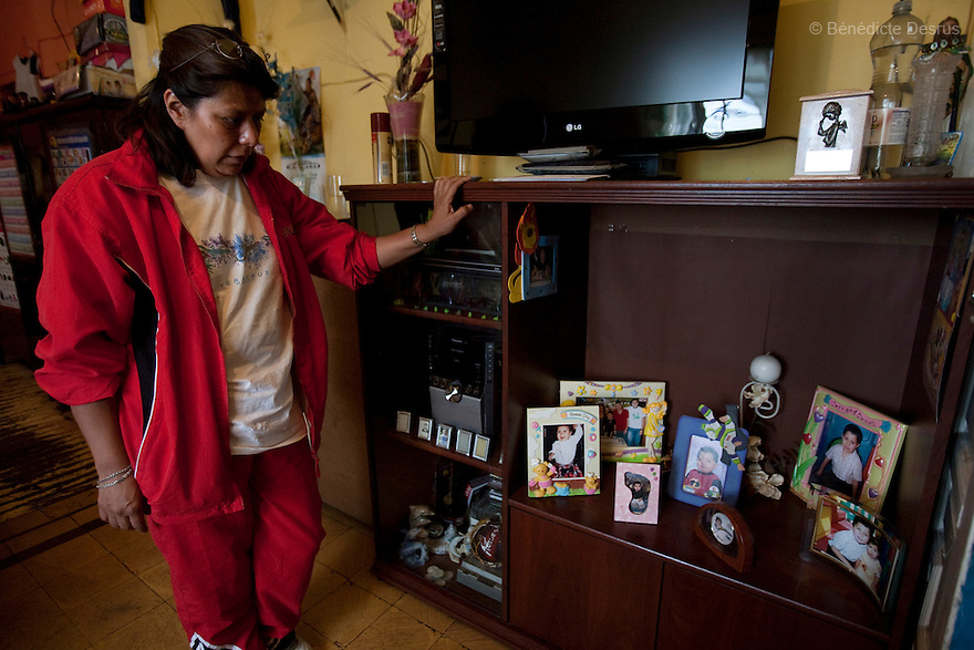 "April 26, 2009 - Mexico City, Mexico - The grandmother of Oscar Corona Perez looks at photos of her dead grandson in her apartment in Mexico City. Oscar, 5 years old, died yesterday after 8 days of treatment at ""La Raza"" national medical center. The family was told on Friday that the medication and operations that had been done had no effect as Oscar had a new illness with no treatment. The next morning he died at 11:00 AM of pneumonia caused by swine Flu. The death toll has risen to over 80 people in Mexico City, and 929 people have the disease. All dead bodies with the influenza must be cremated. Photo credit: Benedicte Desrus / Sipa Press"