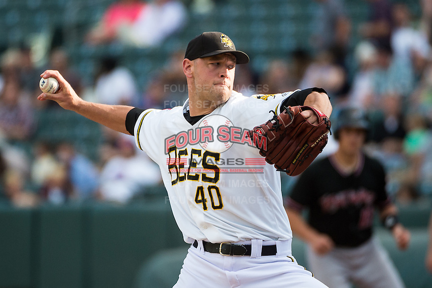 Frank Herrmann (40) of the Salt Lake Bees delivers a pitch to the plate against the Albuquerque Isotopes in Pacific Coast League action at Smith's Ballpark on June 8, 2015 in Salt Lake City, Utah.  The Bees defeated the Isotopes 10-7 in game one of a double-header.(Stephen Smith/Four Seam Images)