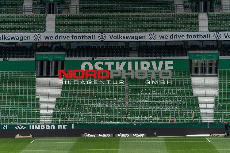 leere Sitzbaenke Stzschalen gruen weiss Ostkurve<br /> <br /> nphgm001 Sport: Fussball: 1. Bundesliga: Saison 19/20: <br /> 26. Spieltag: SV Werder Bremen vs Bayer 04 Leverkusen, 18.05.2020<br /> <br /> Foto ©  gumzmedia / Nordphoto / Andreas Gumz / POOL <br /> <br /> Nur für journalistische Zwecke! Only for editorial use!<br />  DFL regulations prohibit any use of photographs as image sequences and/or quasi-video.