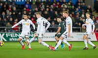 Sergio Aguero of Manchester City gets a shot away surrounded by Swansea players during the EPL - Premier League match between Swansea City and Manchester City at the Liberty Stadium, Swansea, Wales on 13 December 2017. Photo by Mark  Hawkins / PRiME Media Images.