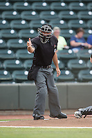 Home plate umpire Zach Tieche makes a strike call during the Carolina League game between the Potomac Nationals and the Winston-Salem Dash at BB&T Ballpark on July 15, 2016 in Winston-Salem, North Carolina.  The Dash defeated the Nationals 10-4.  (Brian Westerholt/Four Seam Images)