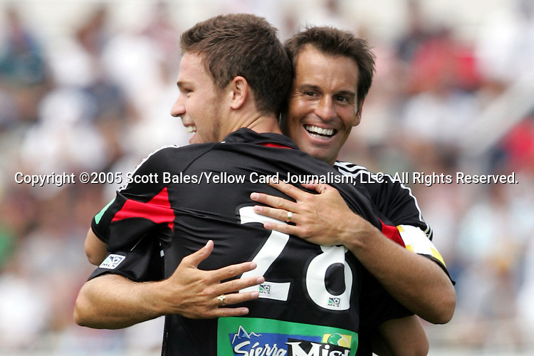 29 August 2005: Newly elected Hall of Famer and DC United Captain John Harkes congratulates Shawn Kuykendoll on his first-half goal. The Colorado Rapids defeated DC United 6-2 at At-A-Glance Field in Oneonta, New York in the 2005 Hall of Fame Game..