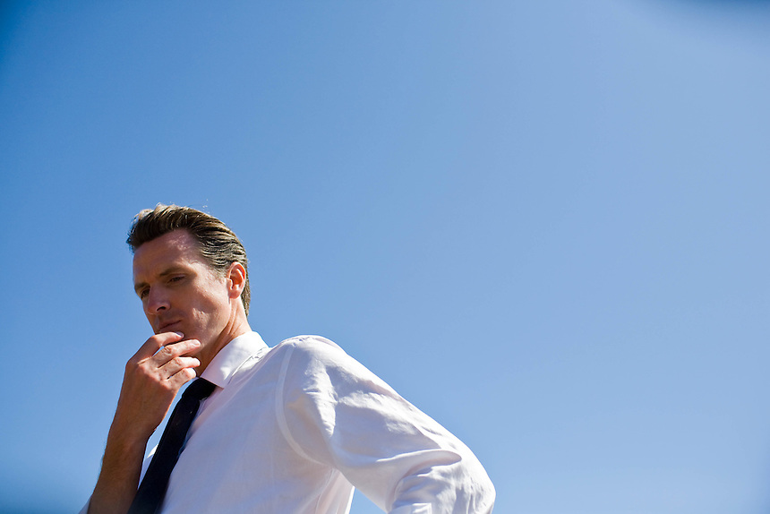 Mayor Gavin Newsom ponders a question from a reporter after giving a speech at San Francisco State University against Propositions 4 and 8 on September 18, 2008. Lieutenant Gubernatorial Candidate Gavin Newsom stands against a blue sky in San Francisco, Calif.