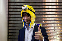A young Japanese man wearing a Minion hat during the Halloween celebrations in Shibuya, Tokyo, Japan. Wednesday October 31st 2018 .  Halloween has grown massively popular  in Japan over the last few yers. Primarily an event for young adults who use it as a chance to dress up in inventive costumes and spend the night partying . In recent years the misbehaviour of some revellers has caused a heavier police presence on the street and  a push back from the Japanese society, and media  who see no need for nor benefits to this western cultural import.