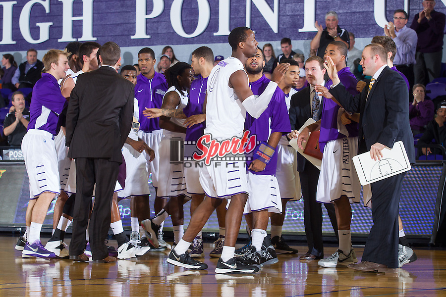 John Brown (0) of the High Point Panthers is high fived after making a play during second half action against the Wofford Terriers at Millis Athletic Center on November 24, 2013 in High Point, North Carolina.  The Panthers defeated the Terriers 66-56.   (Brian Westerholt/Sports On Film)