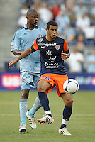 Younes Belhanda (10) midfield Montpellier watched by Julio Cesar (55) midfield Sporting KC..Sporting Kansas City were defeated 3-0 by Montpellier HSC in an international friendly at LIVESTRONG Sporting Park, Kansas City, KS..