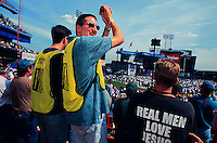 (011014-SWR06.jpg) QUEENS, NEW YORK - THE PROMISE KEEPERS, an all men Evangelical Christian organization gathers in Shea Stadium for three days of prayer and worship...Photo © Stacy Walsh Rosenstock.stacy@stacyrosenstock.com.212) 777 0258