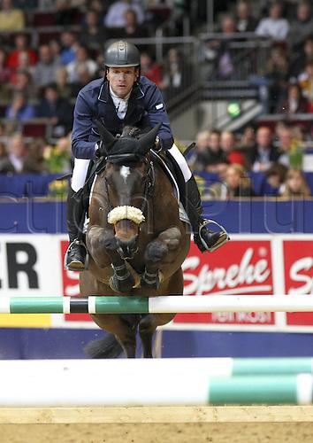 20 03 2010  Dortmund Westfalenhalle 20 03 2010 Jump Championship from Dortmund Markus Merschformann ger and petite Golda 2 Photo Equestrian sports riding show jumping Dortmund