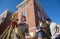 A group of students survey the Drill Field during a recent sunny day on campus as part of a class assignment. Pictured, from left to right, are Payton Billingsley, a sophomore civil engineering major from Rockland, Maine, Nick Perry, a sophomore building construction science major from Meridian, and Daniel Powell, a senior agricultural engineering technology and business major from Philadelphia. Students have this week off from classes as part of the university's spring break.<br />  (photo by Megan Bean / &copy; Mississippi State University)