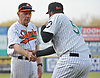 Long Island Ducks owner and coach Bud Harrelson shake hands with newly-signed pitcher Francisco Rodriguez #57 during pregame introductions that preceded the team's season home opener against the Southern Maryland Blue Crabs at Bethpage Ballpark in Central Islip, NY on Friday, May 4, 2018.