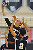 Ashley Chieca #22 of Lindenhurst tries to get a spike past Ashley Levatino #2 of Sachem North during a Suffolk County varsity girls volleyball match at Lindenhurst High School on Wednesday, Oct. 5, 2016. Lindenhurst won the match 3-0.
