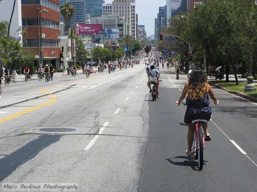 During CicLAvia on June 23, 2013 6 miles of Wishire Blvd. were entirely closed to cars and motorized vehicles.  The street was filled with thousands upon thousands of bicyclists, pedestrians, roller skaters, roller bladers, skate boarders and scooters!  Taken just west of Norton Ave looking east towards downtown LA.
