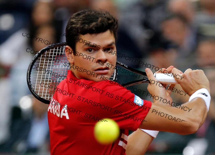 Tennis Tenis<br /> Davis Cup semifinal polufinale<br /> Serbia v Canada<br /> Novak Djokovic v Milos Raonic<br /> Milos Raonic returns the ball<br /> Beograd, 15.09.2013.<br /> foto: Srdjan Stevanovic/Starsportphoto &copy;