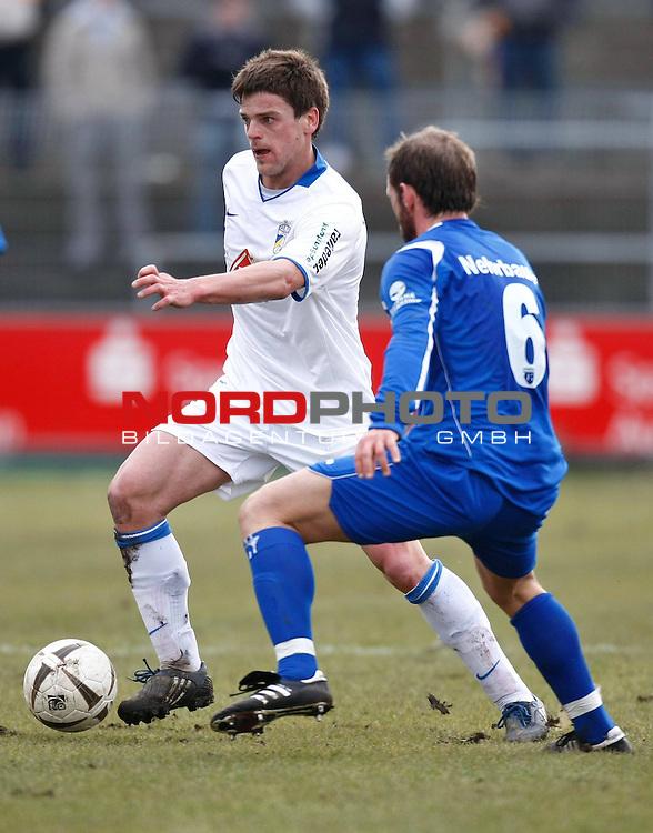 FBL III  2008/2009  R&uuml;ckrunde 23. Spieltag <br /> BSV Kickers Emden - FC Carl Zeiss Jena  <br /> Torsten Ziegner (FC Carl Zeiss Jena #7) - Thorsten Nehrbauer (Kickers Emden GER #6)<br /> <br /> Foto &copy; nph (  nordphoto  )<br /> <br /> <br /> <br />  *** Local Caption ***