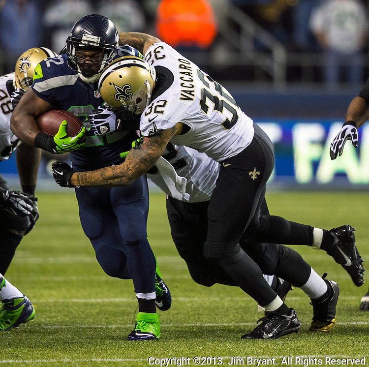 Seattle Seahawks running back Robert Turbin (22)  runs up the middle for a 12- yard gain against New Orleans Saints during the fourth quarter at CenturyLink Field in Seattle, Washington on December 2, 2013. Lynch rushed for 34 yards as Seahawks became the first team to clinch a spot in the NFC playoffs with a 34-7 victory over the New Orleans Saints. ©2013. Jim Bryant Photo.ALL RIGHTS RESERVED.