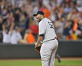 Baltimore, MD - May 8, 2009 -- New York Yankees pitcher C.C. Sabathia (52) lets out a shout after retiring Melvin Mora to get the last out in the ninth inning against the Baltimore Orioles at Oriole Park at Camden Yards in Baltimore, MD on Friday, May 8, 2009.  Sabathia pitched a complete game en route to a 4 - 0 victory..Credit: Ron Sachs / CNP.(RESTRICTION: NO New York or New Jersey Newspapers or newspapers within a 75 mile radius of New York City)