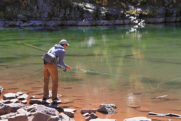 Caucasian fly fisherman, angler, at Dream Lake in Rocky Mountain National Park, west of Estes Park, Colorado. .  John leads private photo tours throughout Colorado. Year-round Colorado photo tours.