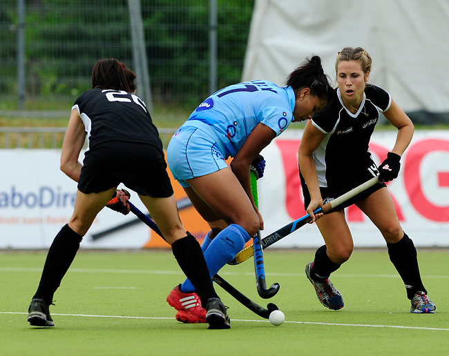 MOENCHENGLADBACH, GERMANY - JULY 28: Match between New Zealand (black) and India (blue) in Pool C during the Hockey Junior World Cup at the Warsteiner HockeyPark on July 28, 2013 in Moenchengladbach, Germany. Final score 0-2. (Photo by Dirk Markgraf/www.265-images.com) *** Local caption *** #22 Cassandra Reid of New Zealand, #19 Elizabeth Keddell of New Zealand, #17 Lily Chanu Mayengbam of India