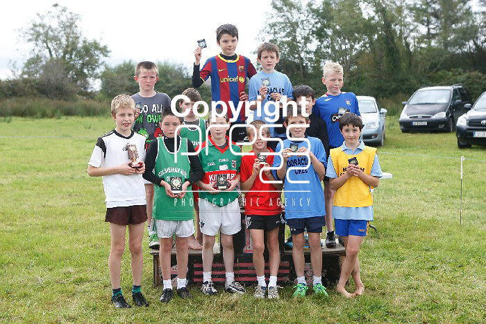 24/9/2012     West Clare National Schools Cross Country Championships in Cooraclare. Our picture shows   1st place winner in the boys U10 Conor Blake from Doonbeg with the other 11 medal and trophy winners. Picture Liam Burke/Press 22