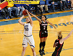 BROOKINGS, SD - FEBRUARY 8: Megan Bultsma #50 of the South Dakota State Jackrabbits lays the ball up past Rayanna Carter #2 of the Omaha Mavericks at Frost Arena February 8, 2020 in Brookings, South Dakota. (Photo by Dave Eggen/Inertia)