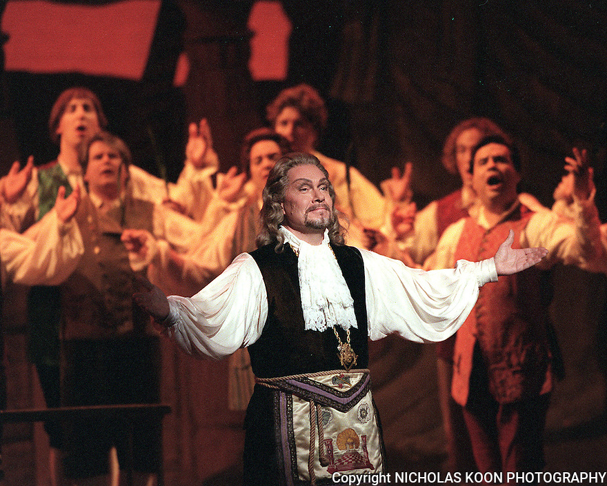 2000 - THE MAGIC FLUTE - The priests are praising Sarastro (Kevin Langan), the high priest, for his wisdom in Opera Pacific's performance of The Magic Flute.