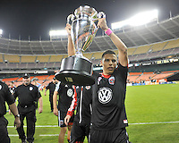 Luis Silva (12) of D.C. United presenting the U.S. Open Cup Trophy to the fans at  the end of the game.  The Chicago Fire defeated D.C. Untied 3-0, at RFK Stadium, Friday October 4 , 2013.