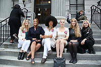 NORRISTOWN, PA - JUNE 16 : Linda Kirkpatrick, Jewel Allison, Lili Bernaro, Caroline Heldman, Therese Serignese and Victoria Vinokar sit on the steps of the Montgomery County Courthouse on the tenth day of Bill Cosby's sexual assault trial and the fourth full day of jury deliberation on June 16, 2017 in Norristown, Pennsylvania.  photo credit  Star Shooter/MediaPunch