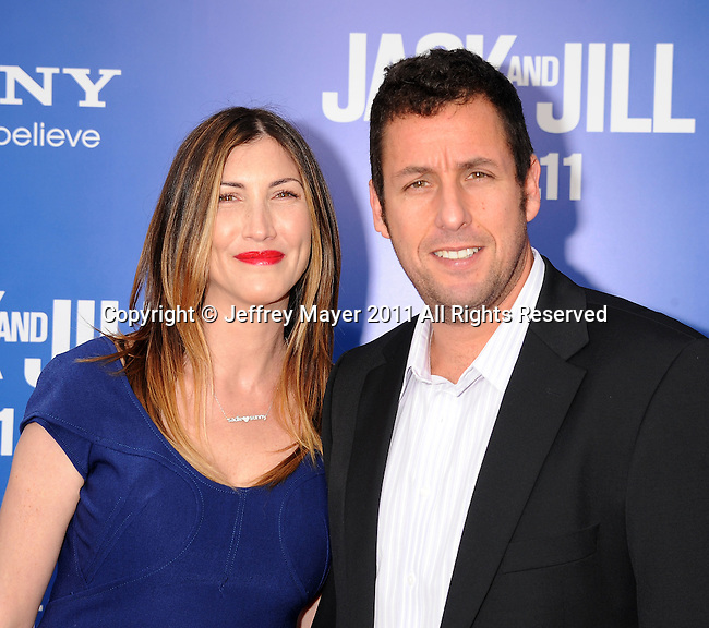 "WESTWOOD, CA - NOVEMBER 06: Jackie Sandler and Adam Sandler arrive for Los Angeles premiere of ""Jack And Jill"" at Regency Village Theatre on November 6, 2011 in Westwood, California."